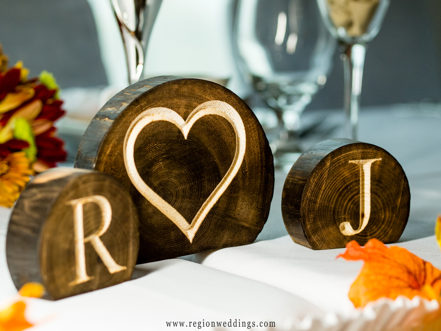 Wooden Fall themed bride and groom table placards.