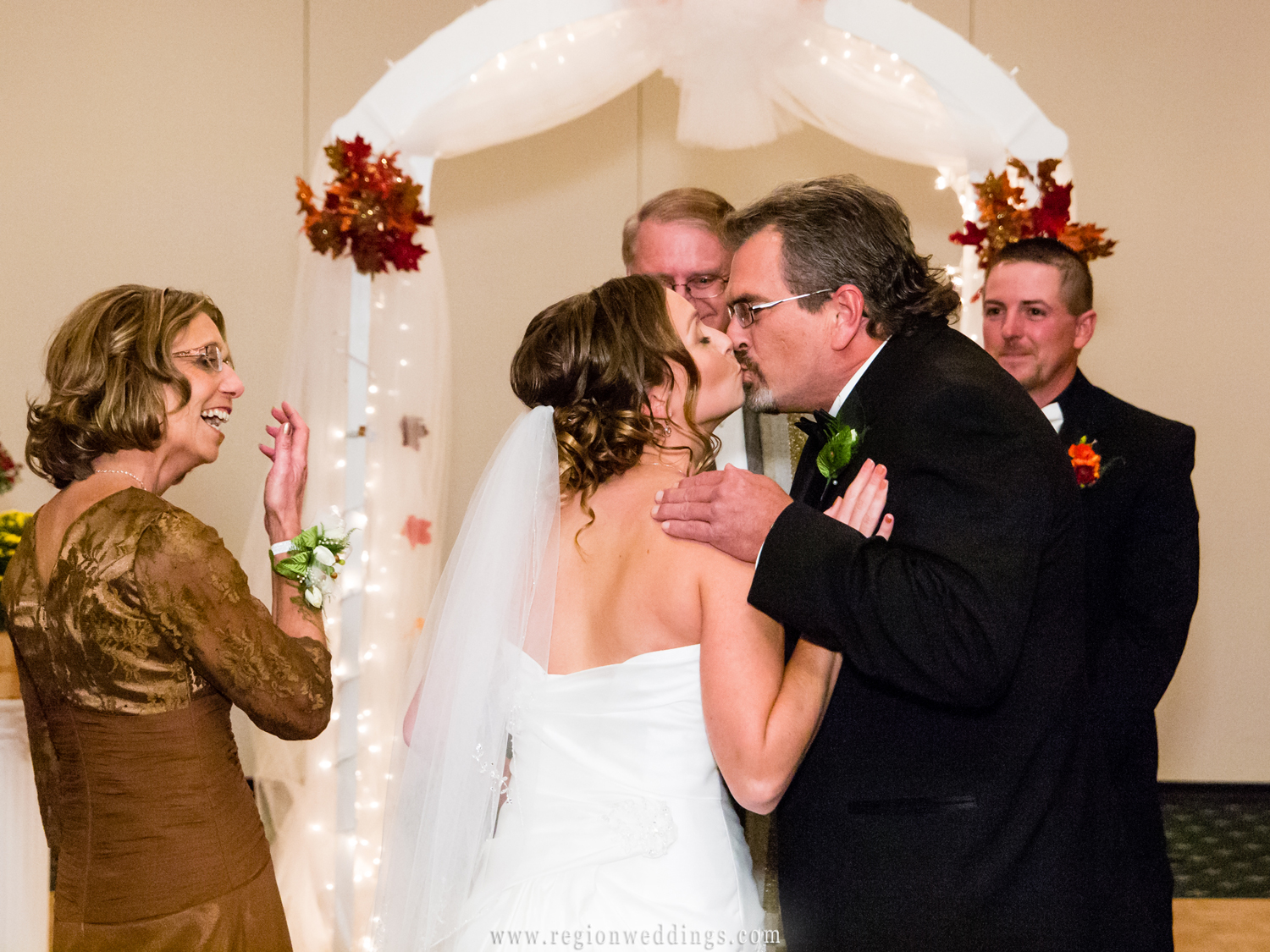 A father gives away his daughter at her fall wedding ceremony.