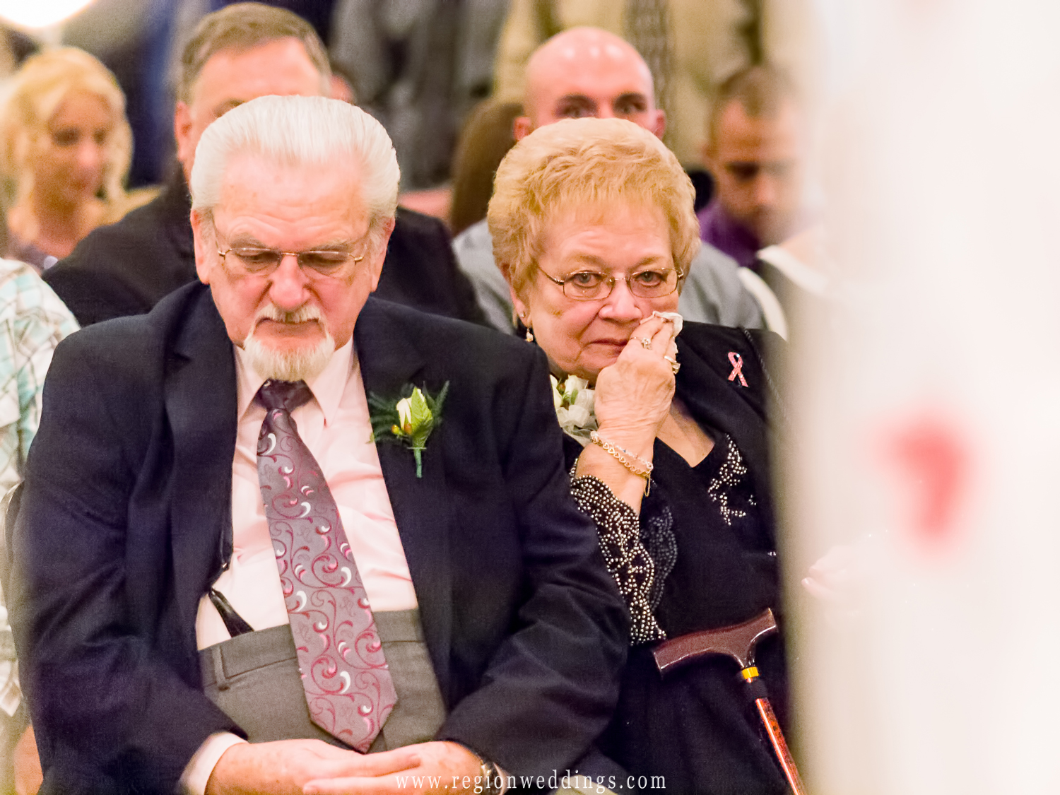Happy tears come forth as grandparents of the bride watch her get married.