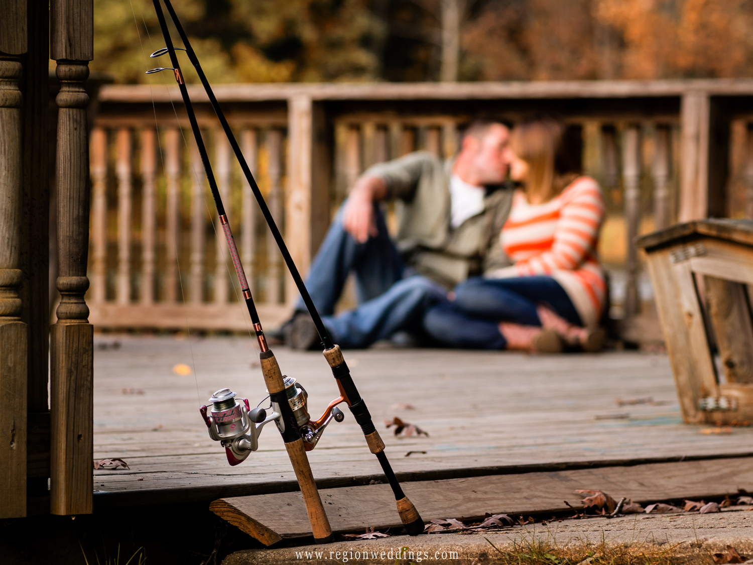 A couple kisses all alone on the pier of Lemon Lake in the Fall.