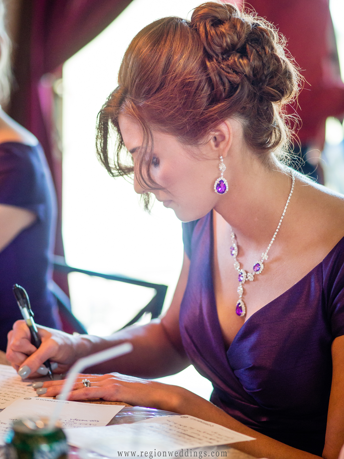 The matron of honor writes her speech for her sister's wedding.