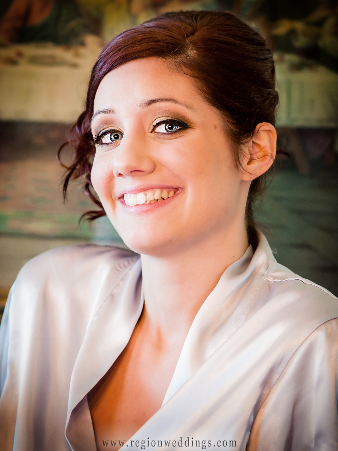 The bride is all smiles on the morning of her wedding.