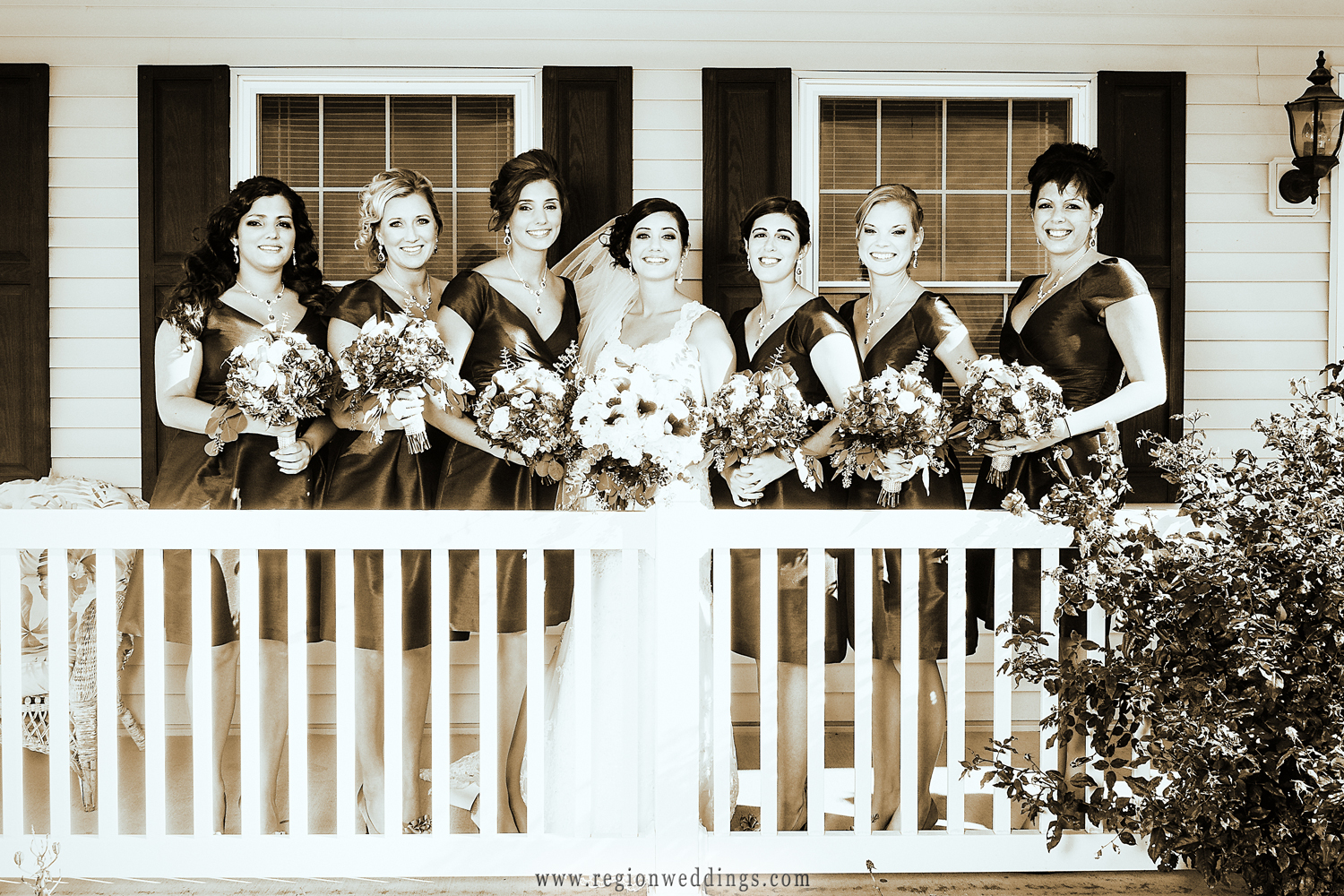 The bride is surrounded by her friends on the porch of her parent's home in Cedar Lake on the morning of her wedding.