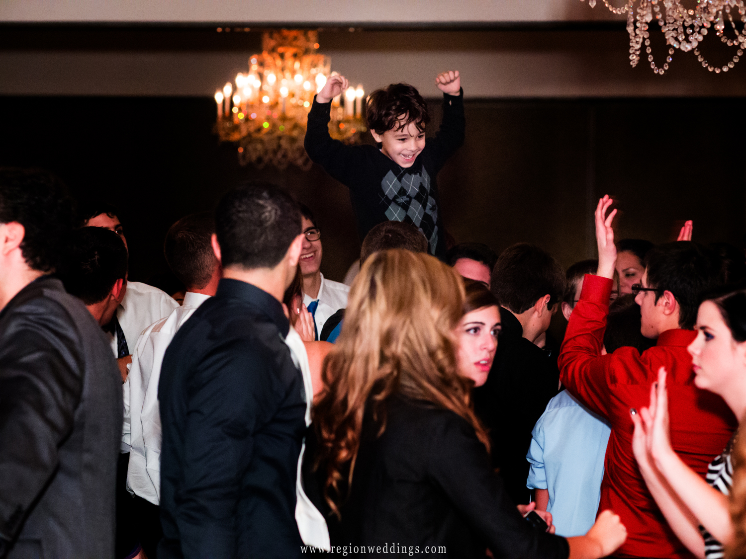 A child crowd surfs at a wedding reception at The Dream Palace in Lynwood, Illinois.
