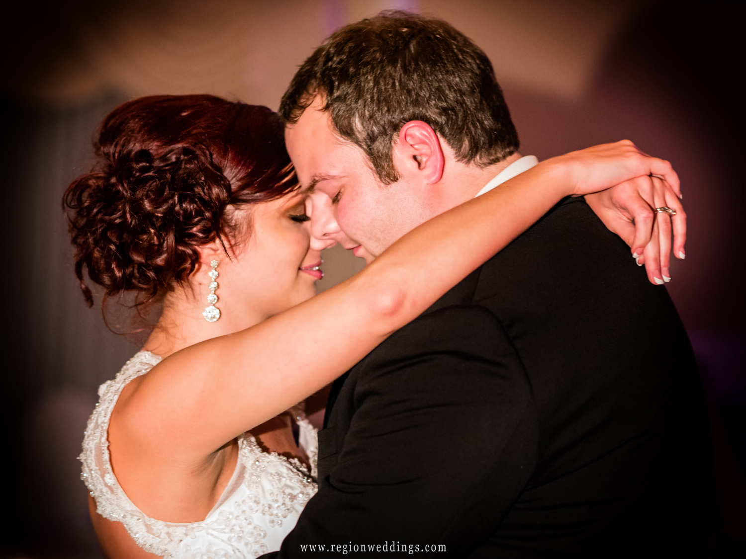 The bride and groom take their first dance during their wedding reception at The Dream Palace in Lynwood, Illinois.