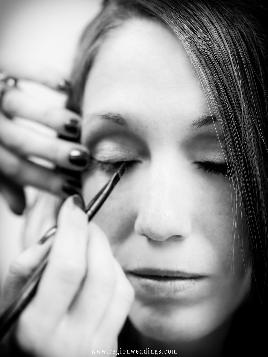 Eye make up gets applied to the bride at a salon in Portage.