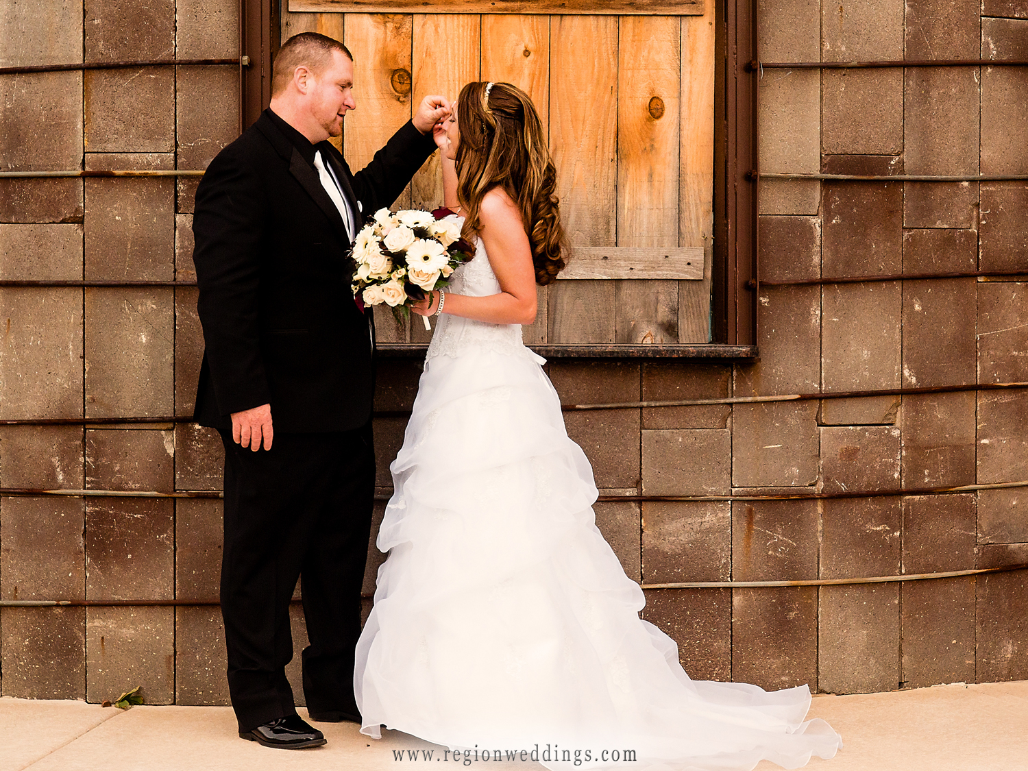 The bride and groom see each other for the first time outside County Line Orchard in Hobart, Indiana.