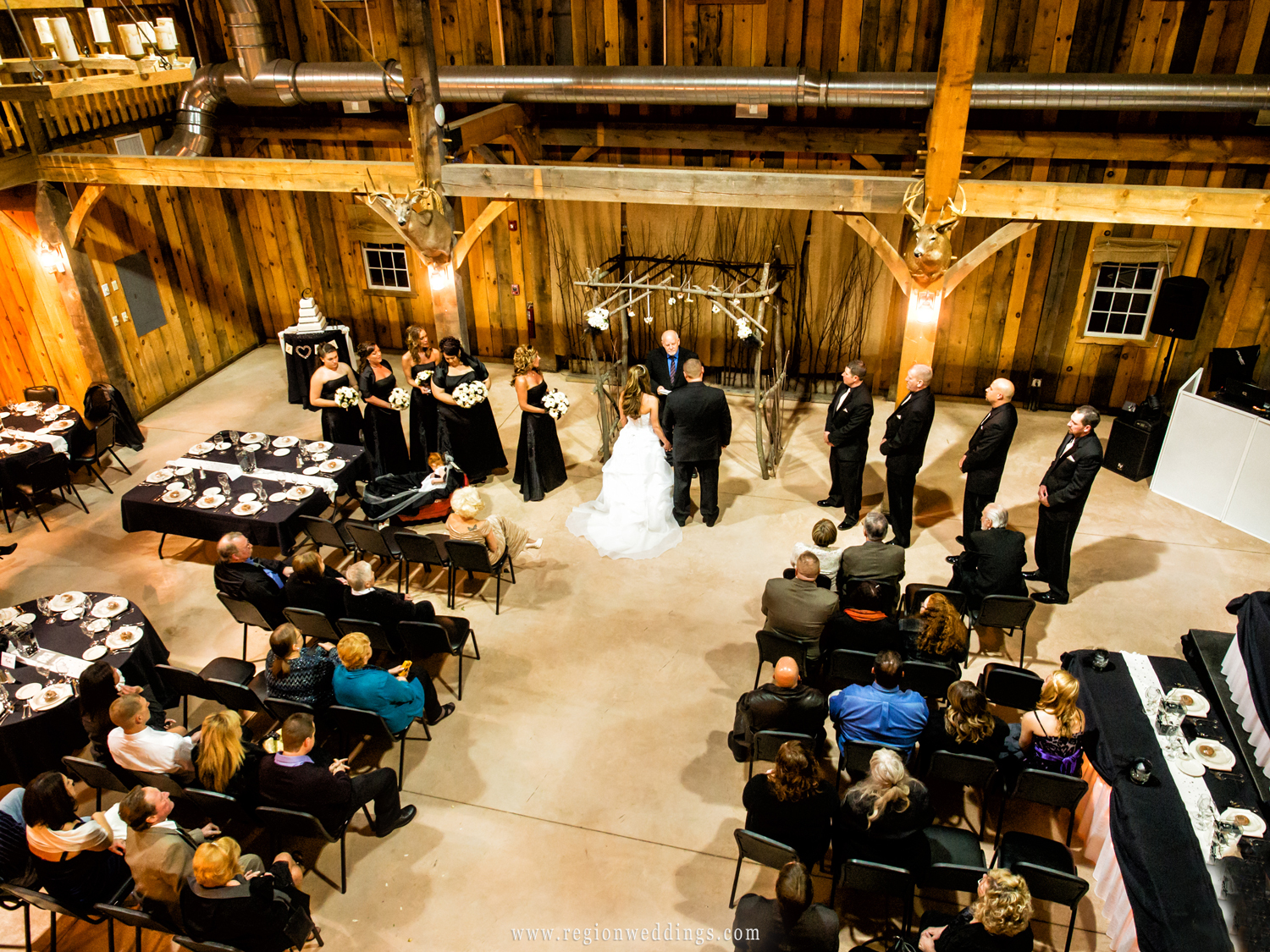 A wedding ceremony photo taken from the balcony of the barn at County Line Orchard.