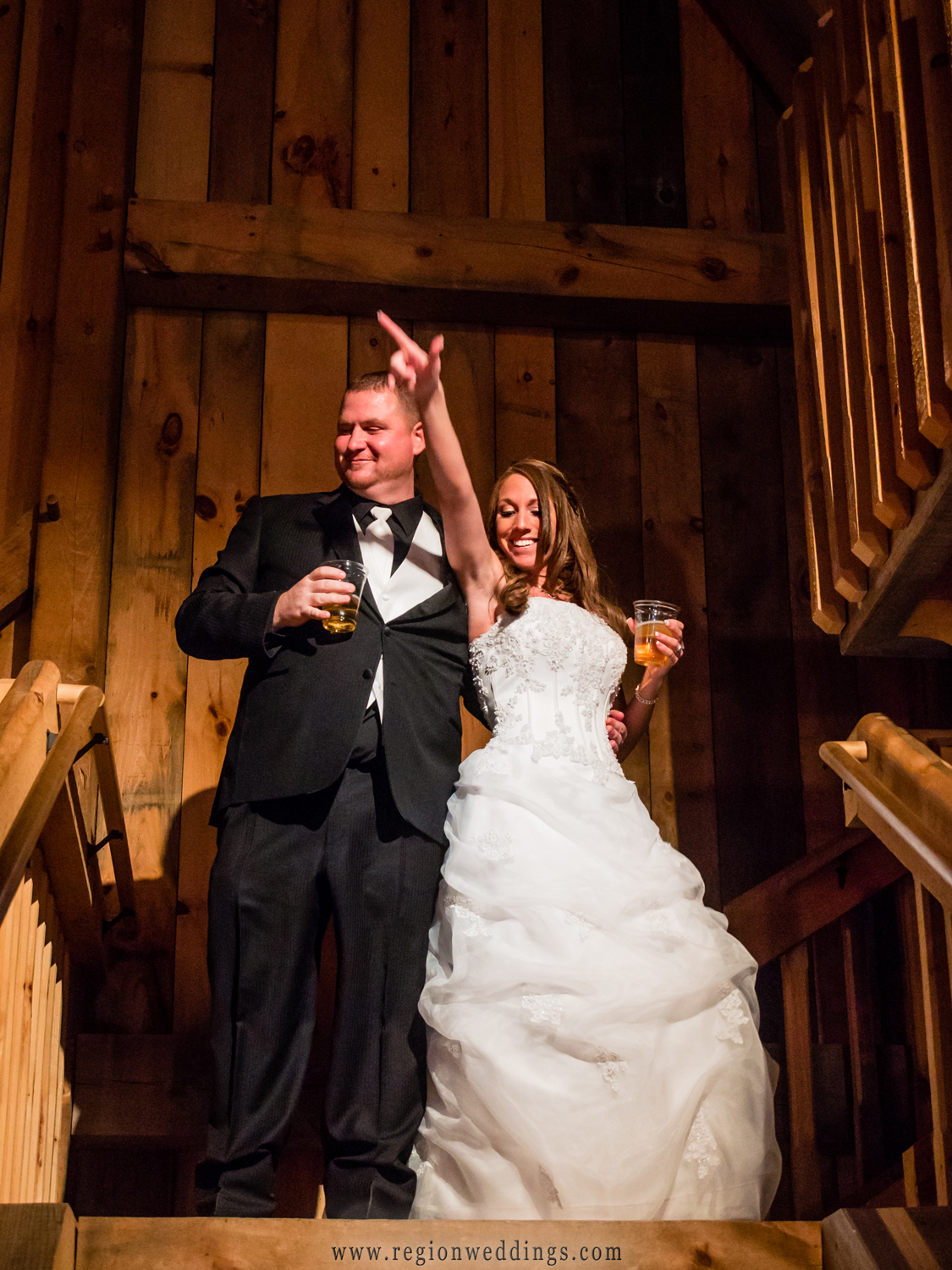 The bride and groom get introuduced at their wedding reception at the rustic looking apple orchard.