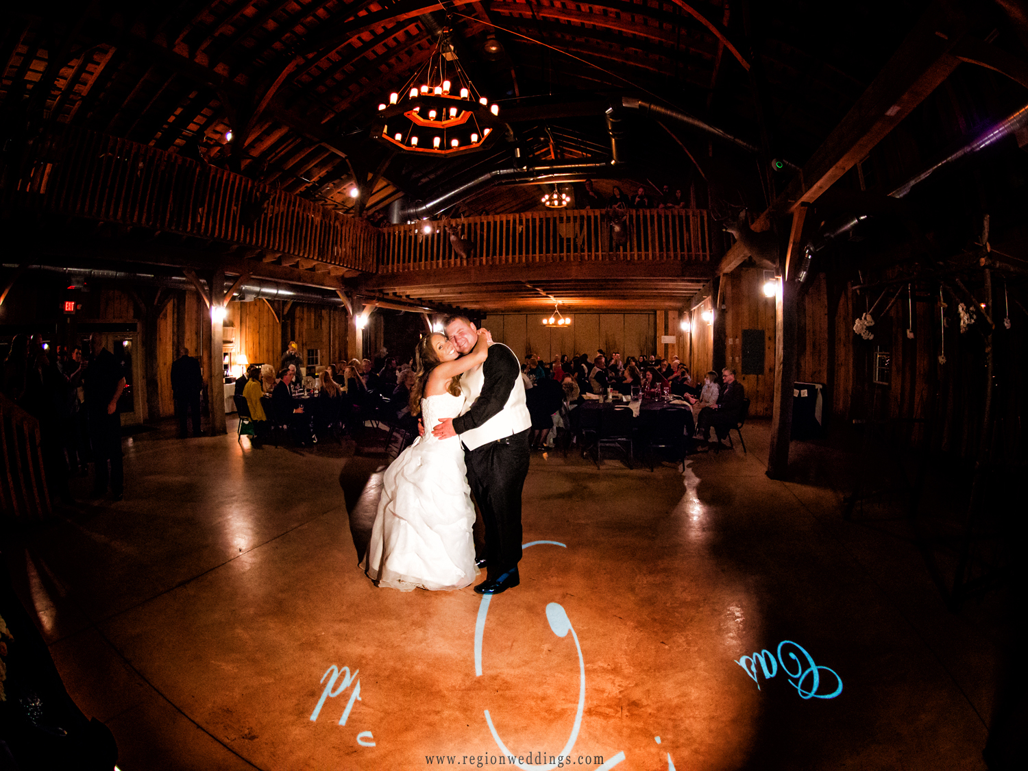 The bride and groom are the center of attention during their first dance at County Line Orchard.