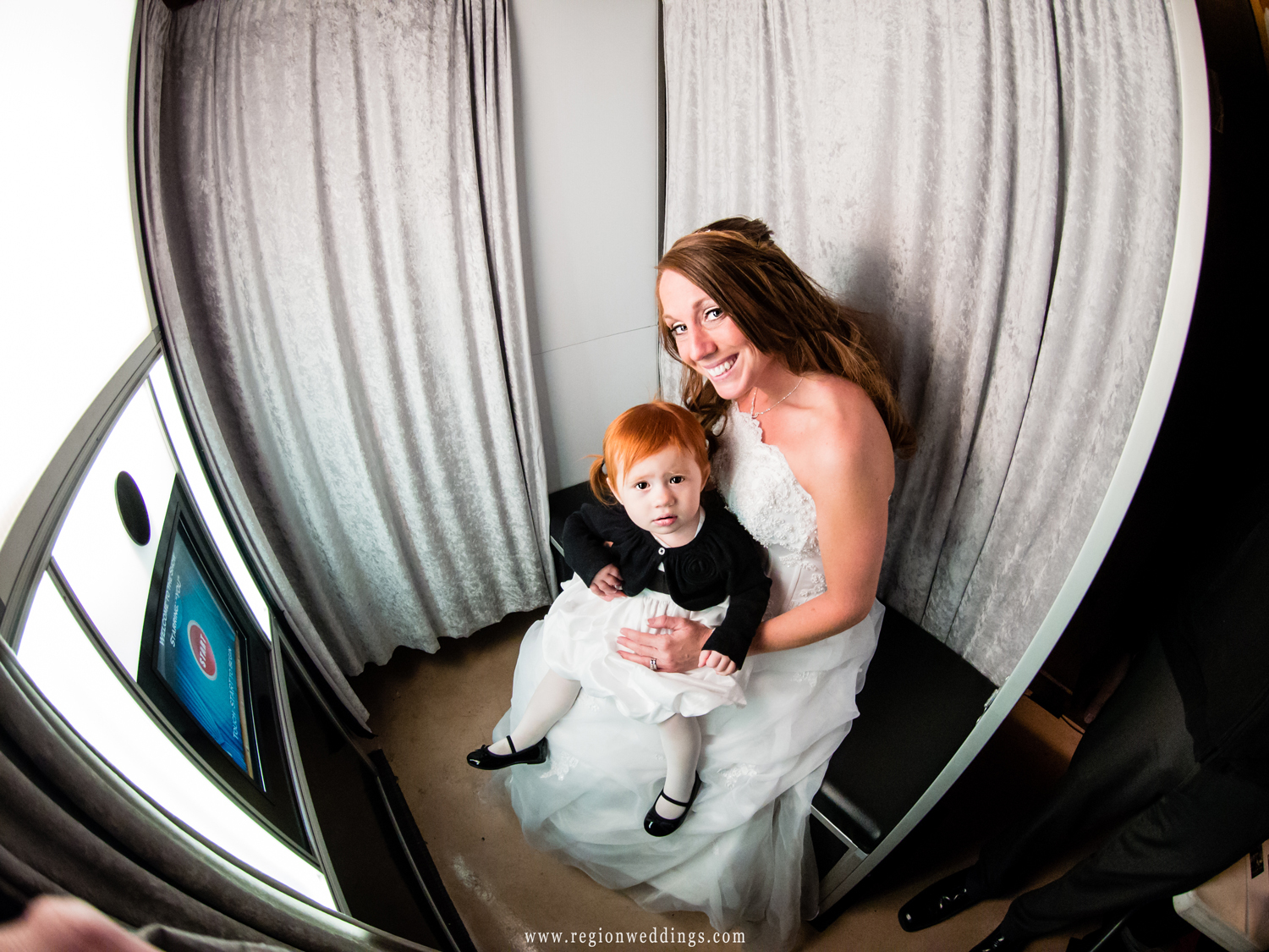Mom and daughter enjoy the Memories in Minutes Photo booth.