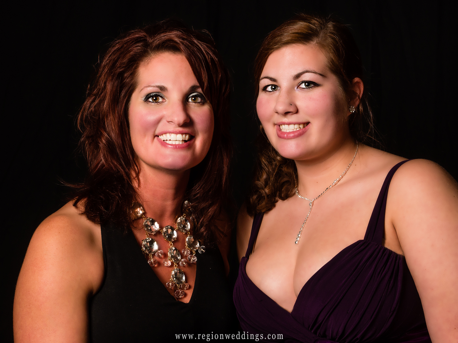A mother and daughter pose for a portrait while attending a friends wedding reception at The Dream Palace in Lynwood, Illinois.