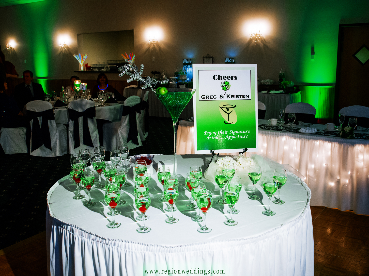A table of green apple martinis greet guests at a winter wedding reception at The Patrician in Schererville, Indiana.