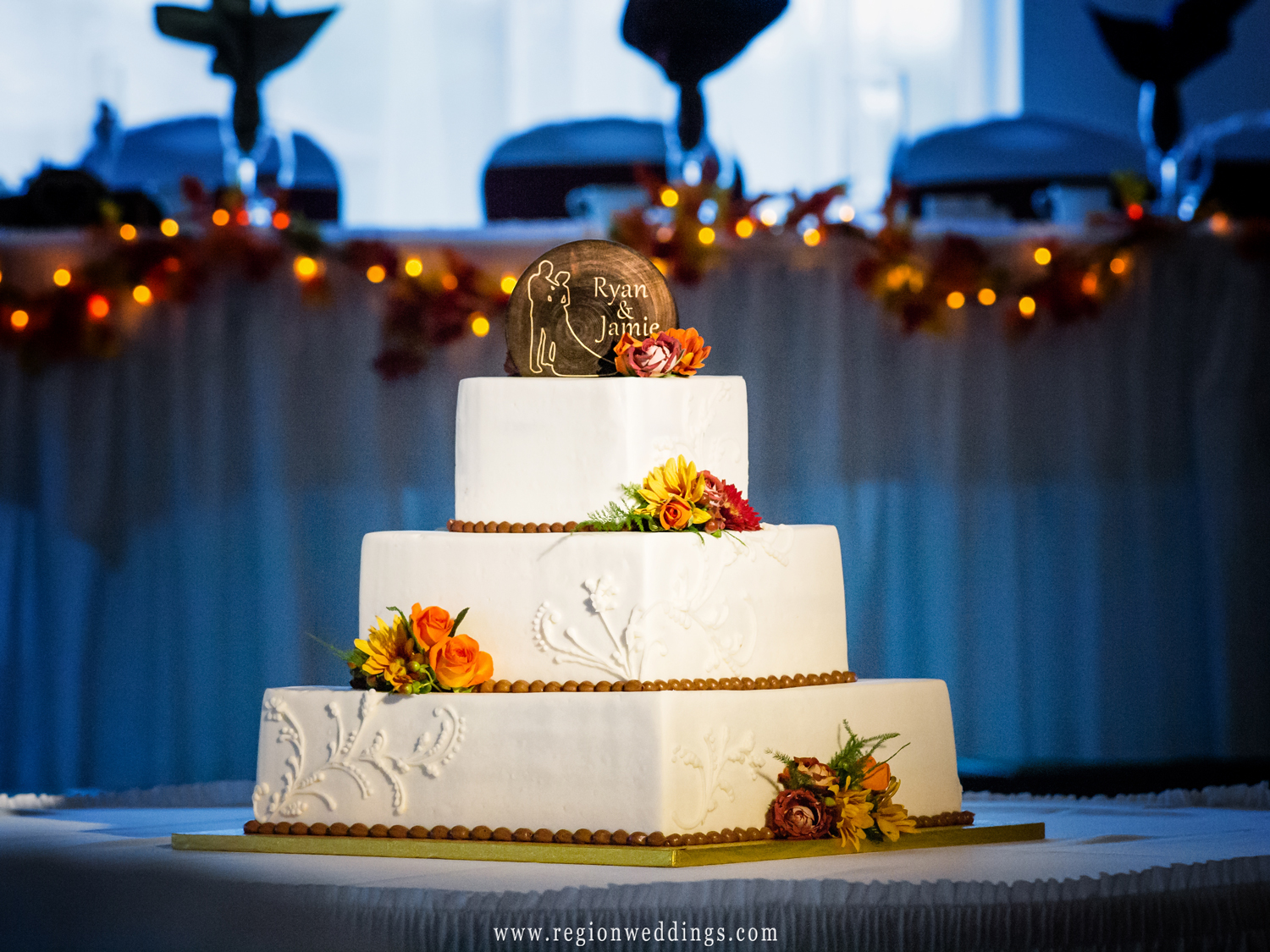 Wedding cake decorated with Autumn leaves and and Fall colors.