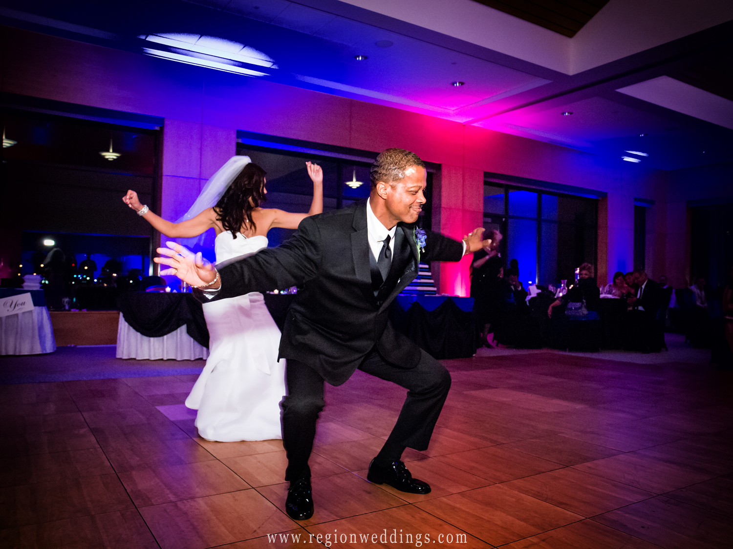 Father and daughter boogie down on the dance floor at the Centennial Park clubhouse.