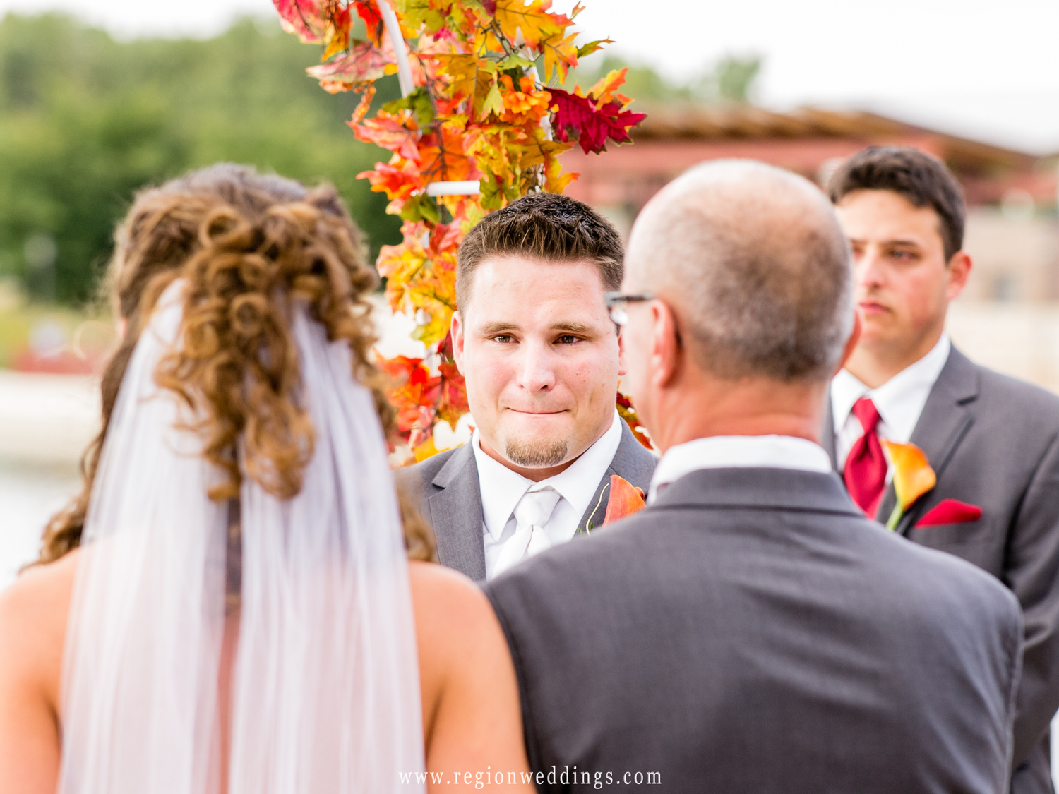 The groom gets emotional as he sees his bride for the first time.