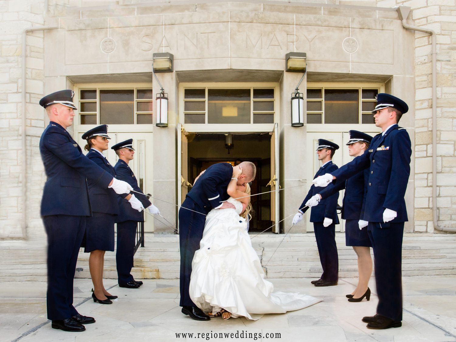 The marine honor guard salutes the bride and groom as they exit Saint Mary's Church in Griffith, Indiana.