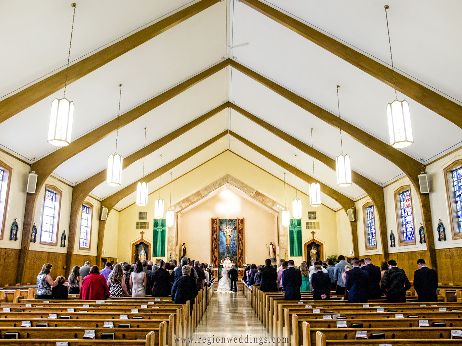 A wide angle view of a wedding ceremony at Saint Mary's Church in Griffith, Indiana.