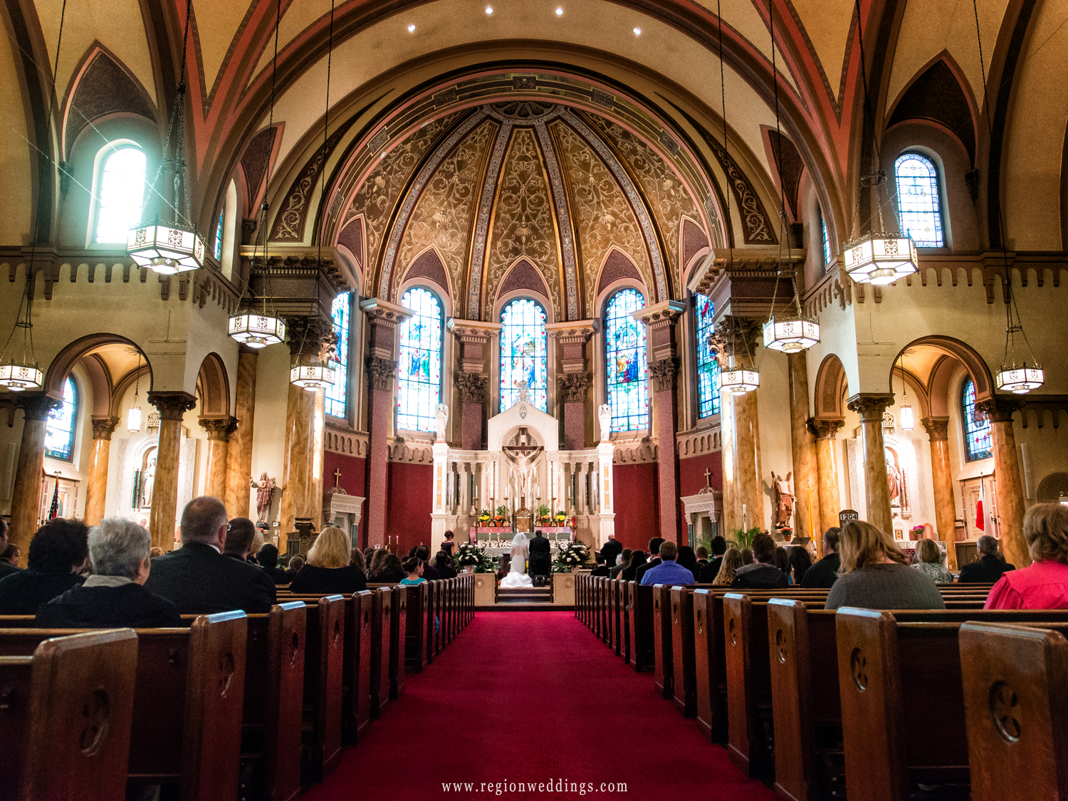 A wide angle view of a wedding ceremony at Saint Andrew's Church in Calumet City.