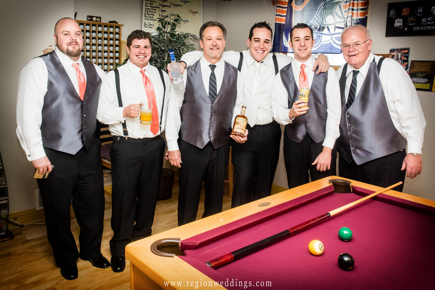 The guys toast the groom on wedding day.
