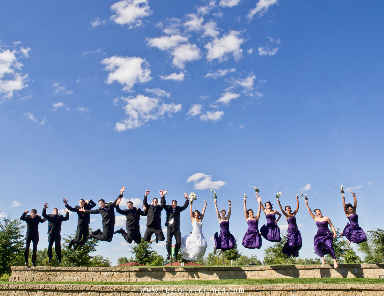 The classic wedding party jumping shot.