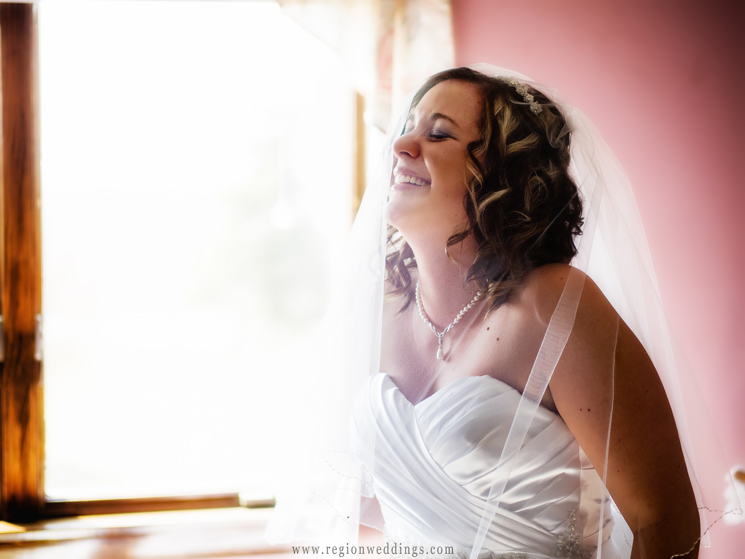 An emotional moment for the bride on wedding day.