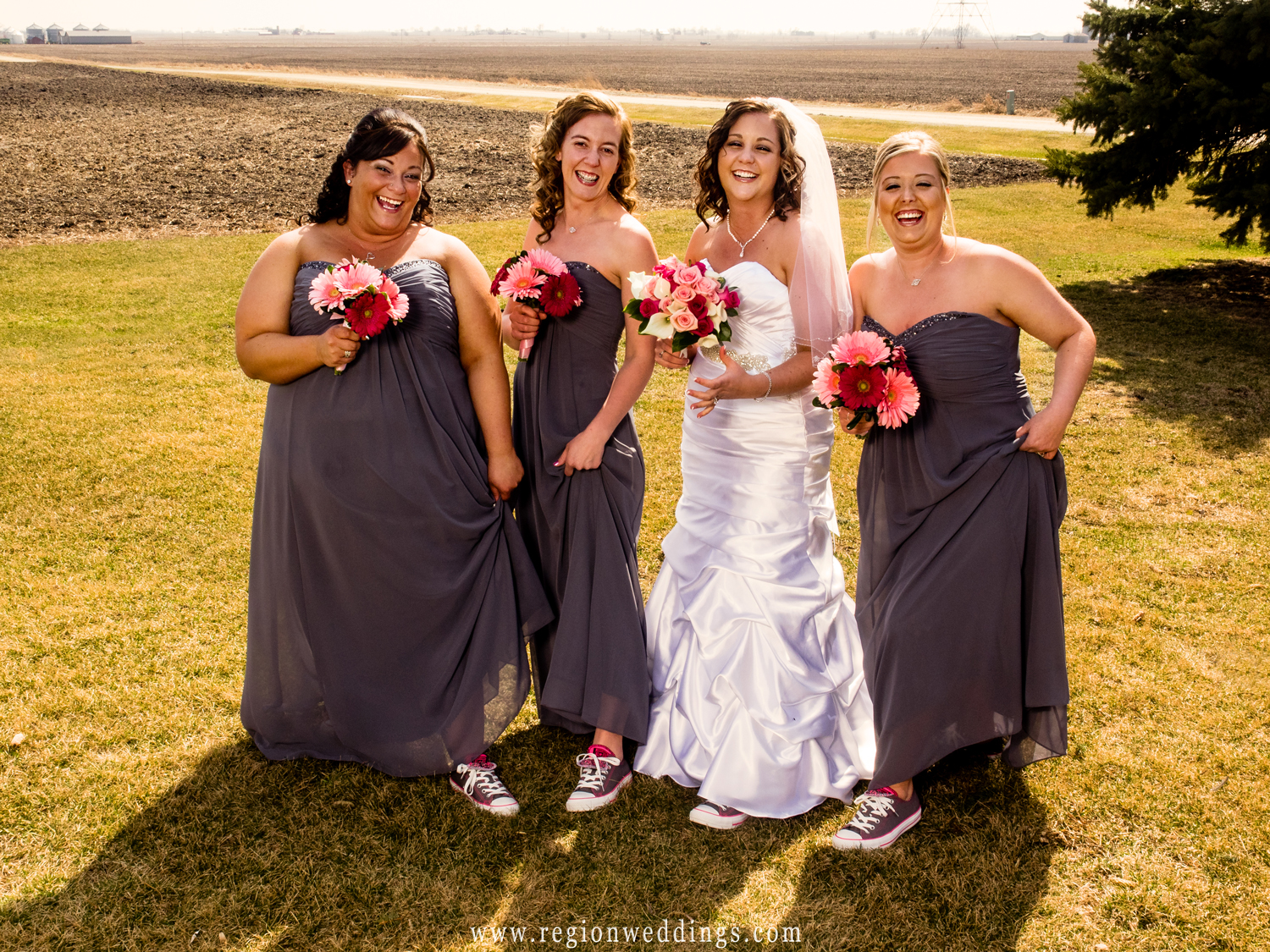 The bridesmaids show off their pink Converse All Stars.
