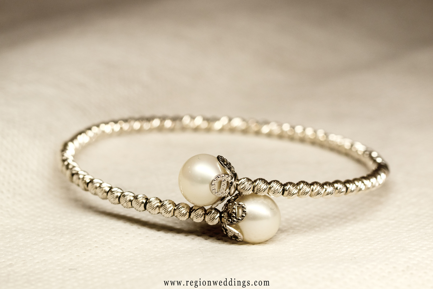 The bride's bracelet shown in a sepia toned wedding photo.