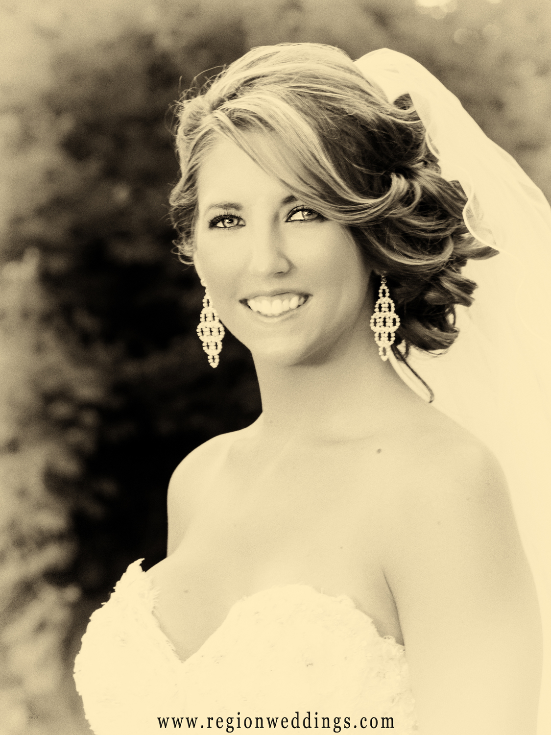 A sepia toned portrait of a bride on her wedding day.
