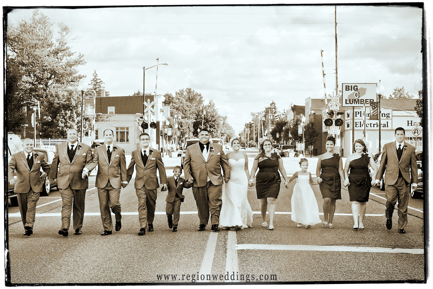 The wedding party takes over the streets in Three Oaks, Michigan.