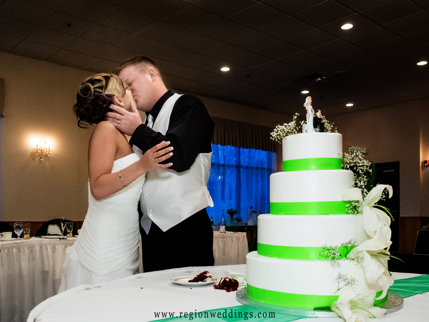 A kiss at the reception after cutting of the cake.
