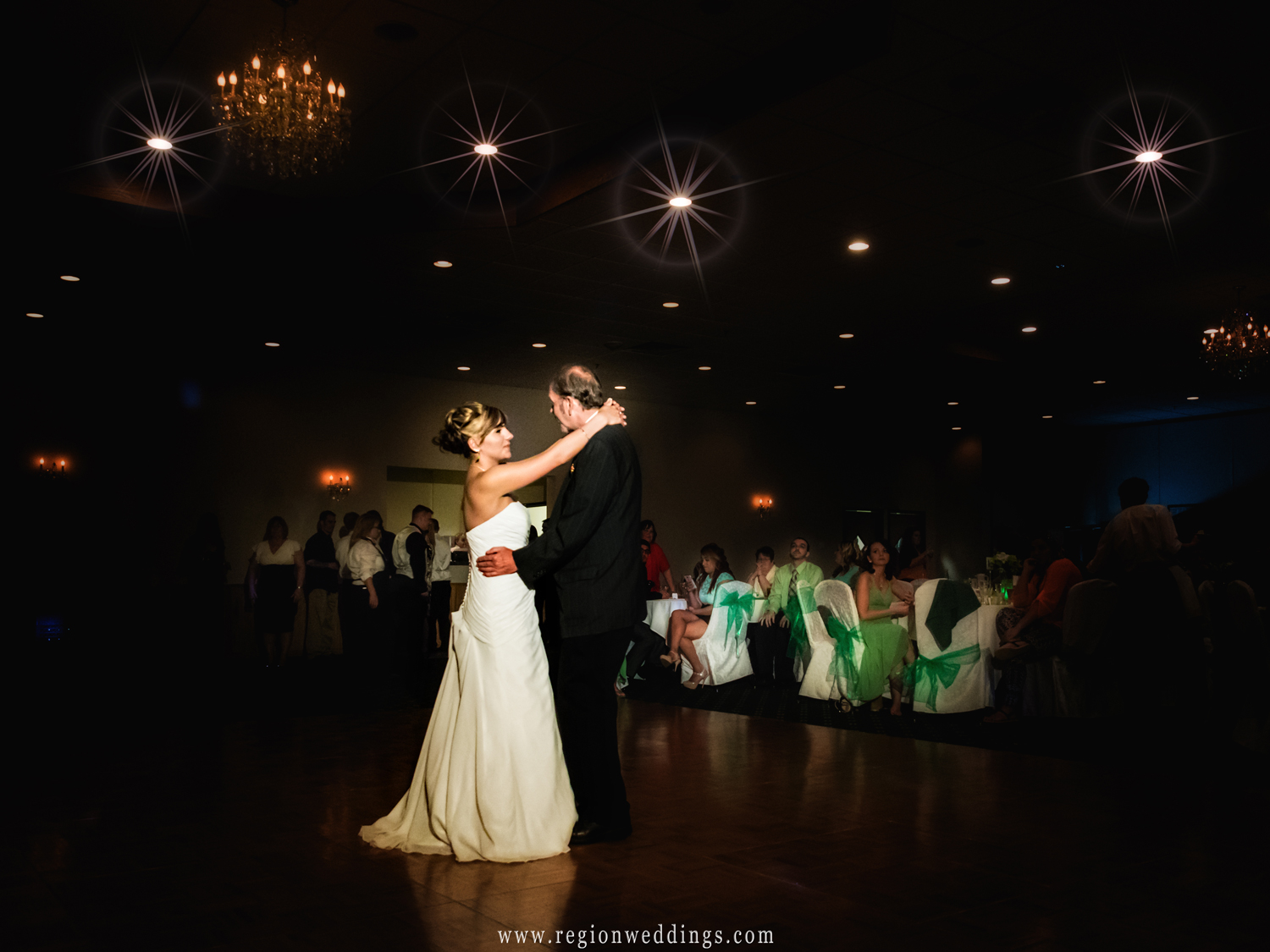 Father and daughter dance in the spotlight.