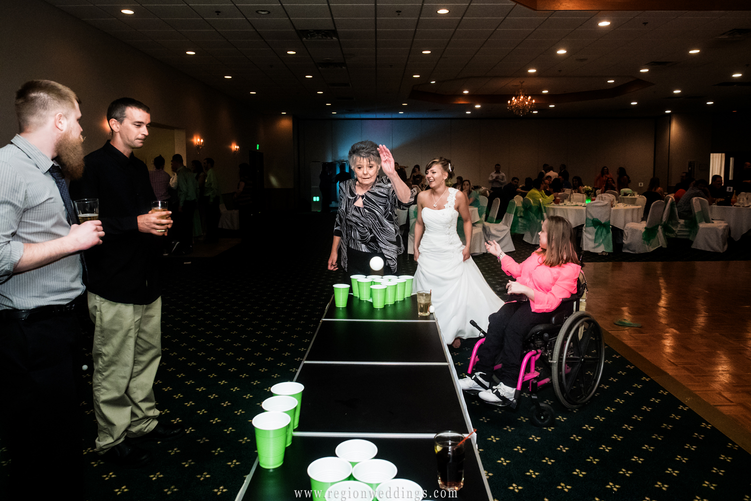 Grandma tries her hand at a little beer pong.