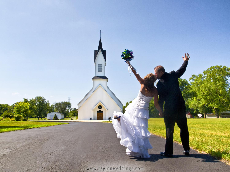 Bride and groom dance toward Grace Lutheran Church in Hobart, Indiana.