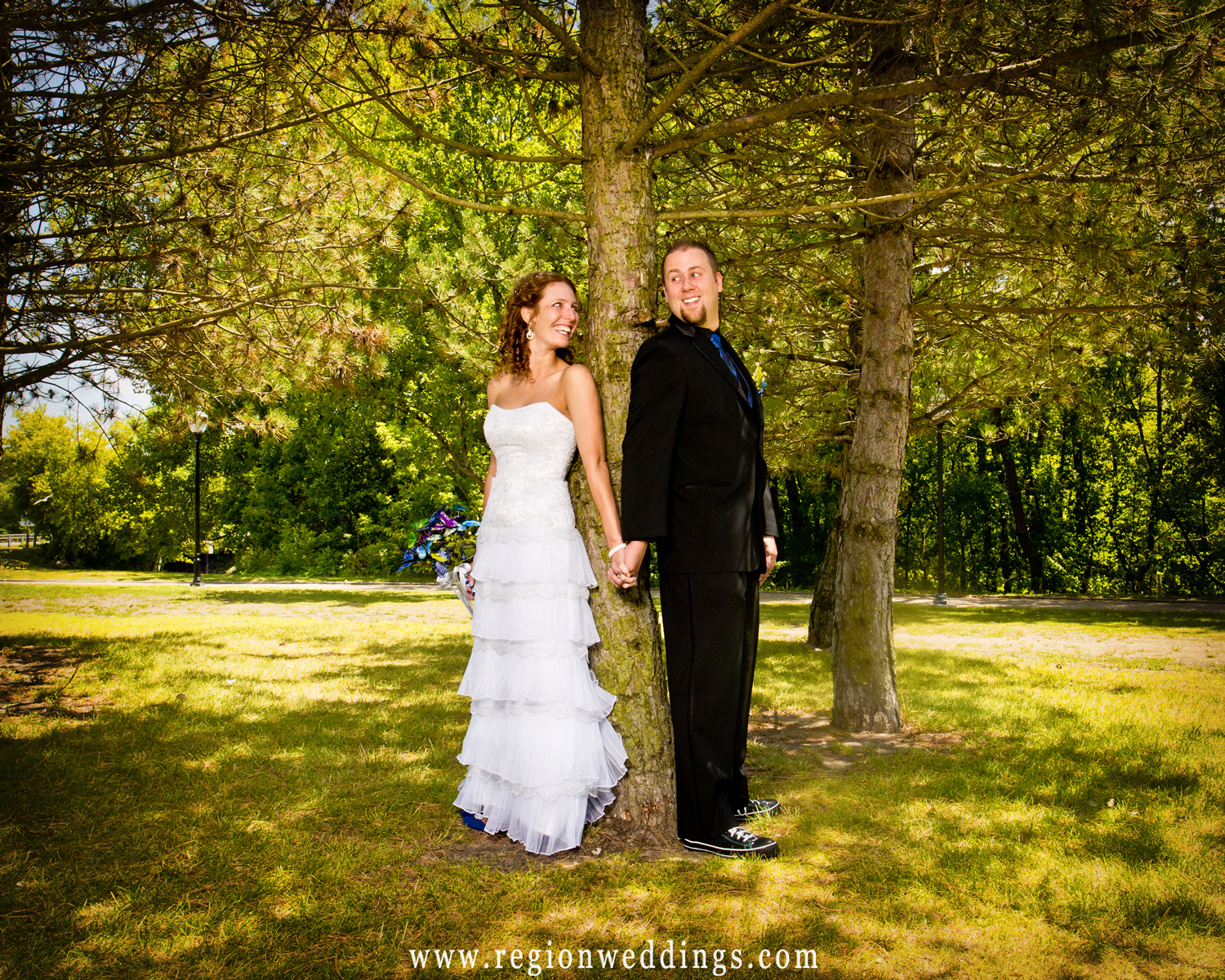 """Bride and groom have a first look, aka """"the reveal"""" at Hobart Lakefront Park in Northwest Indiana."""