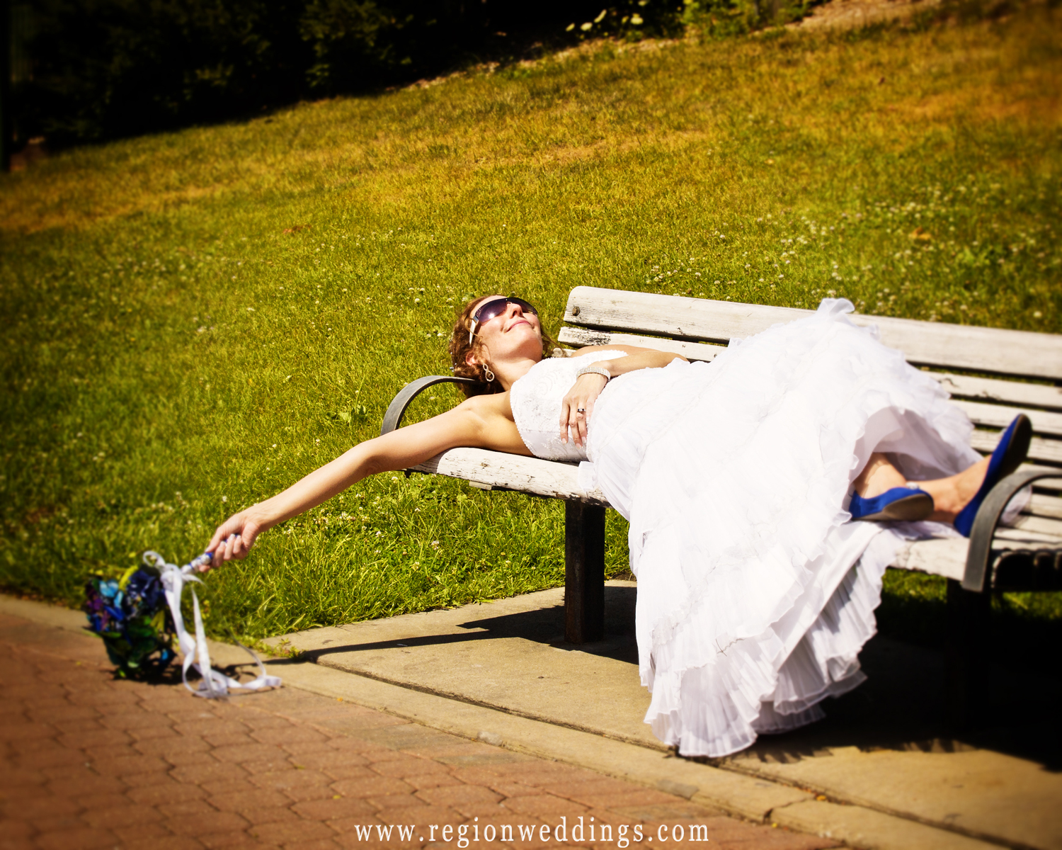 The bride takes a short nap during her wedding photo session in Hobart, Indiana.