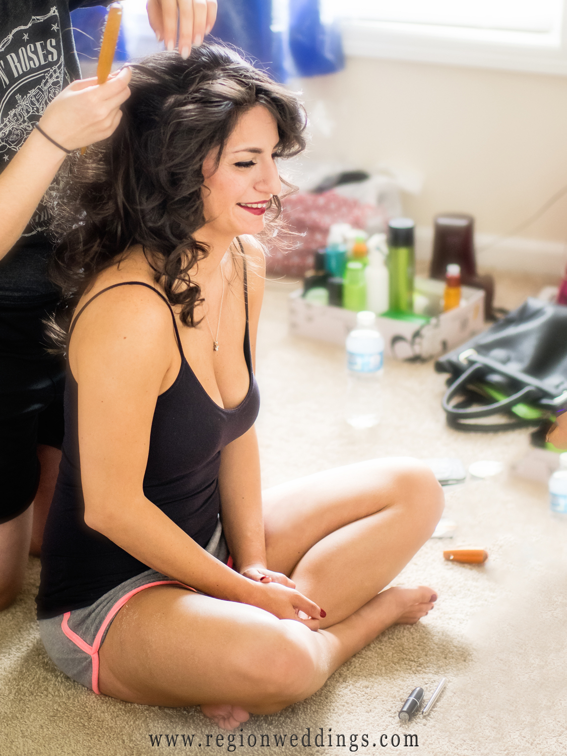 The bride get ready for her big day at her home in Cedar Lake.