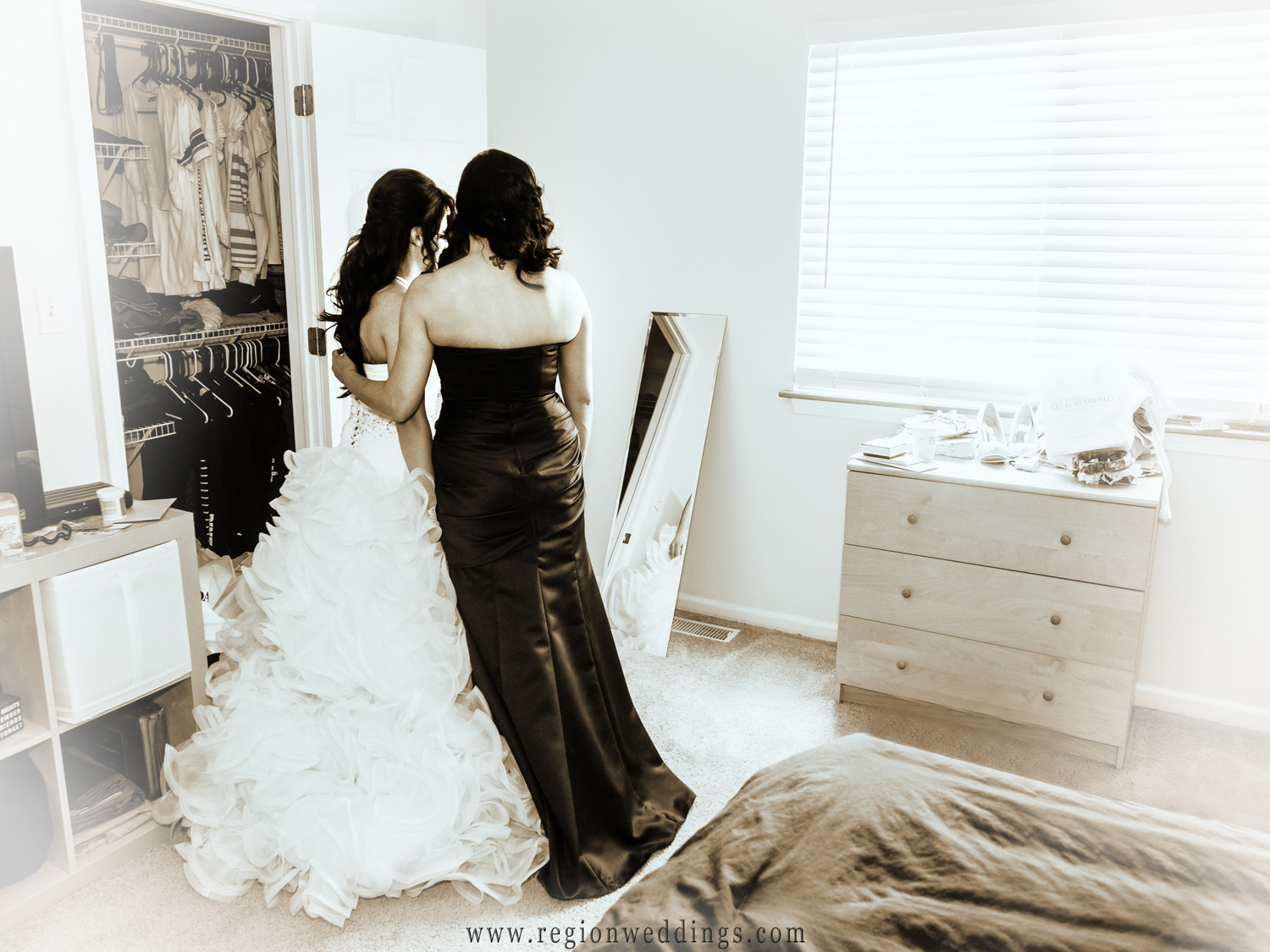 The bride alone with her mother before the ceremony.