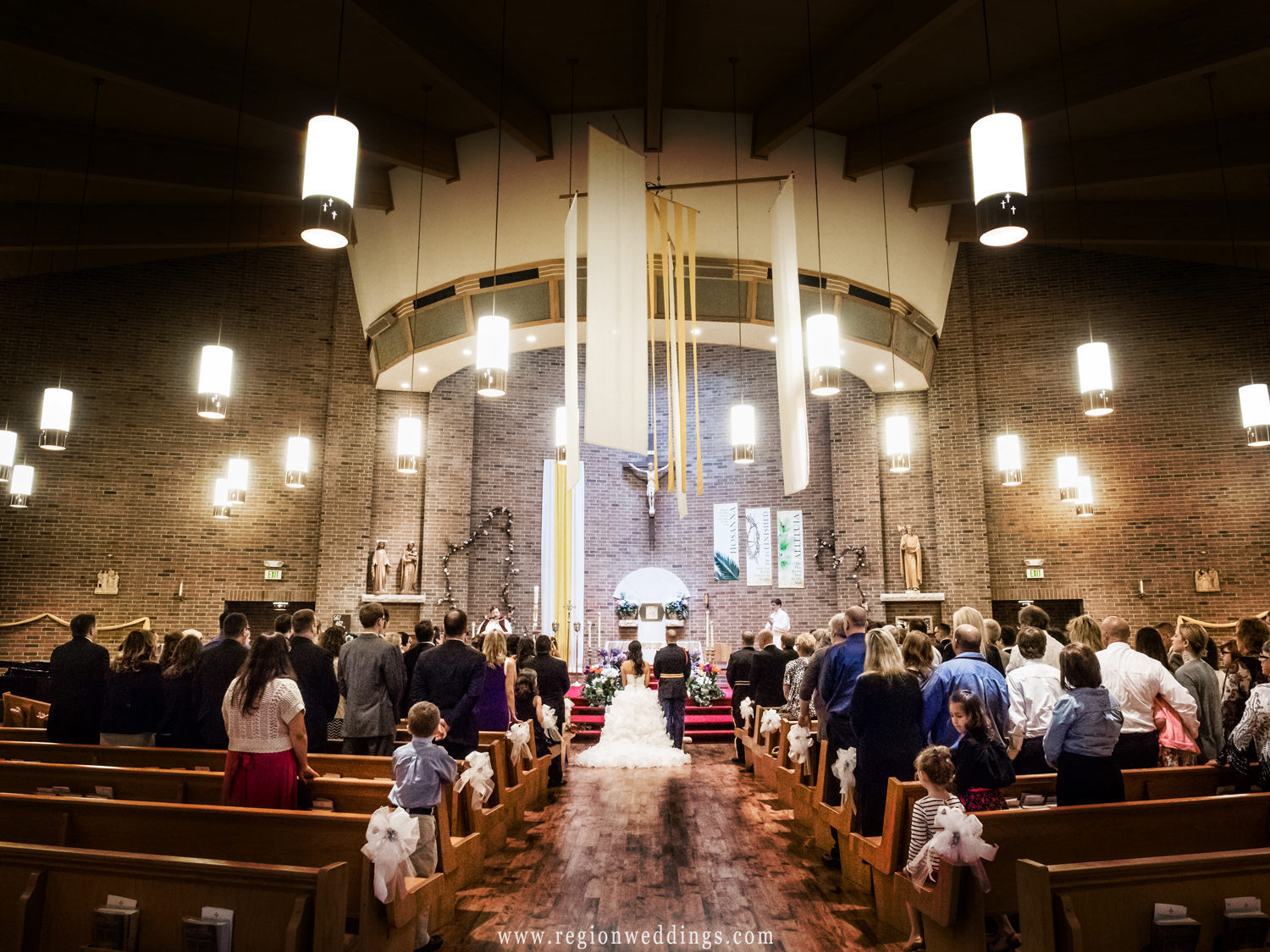 The view from the back of Saint Matthias Church during a Spring wedding ceremony.