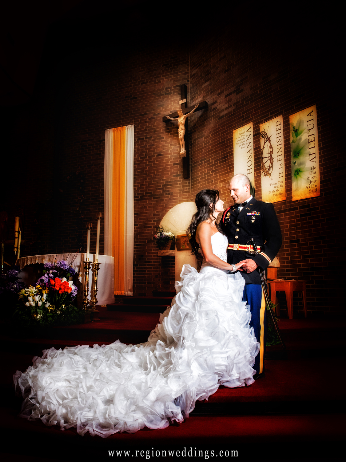 The bride and groom look at each other at the altar of Saint Matthias Church.
