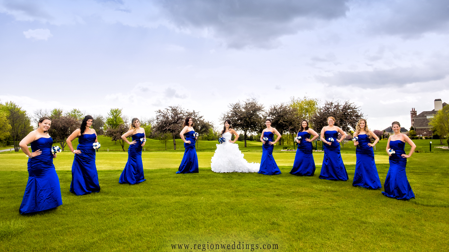 The bridesmaids in their royal blue dresses get sassy at White Hawk Country Club.