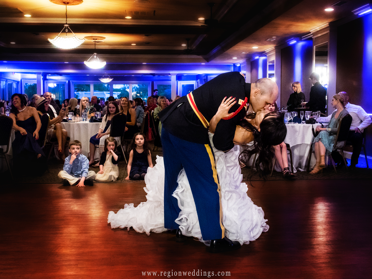 The groom dips his bride during their first dance at White Hawk Country Club.