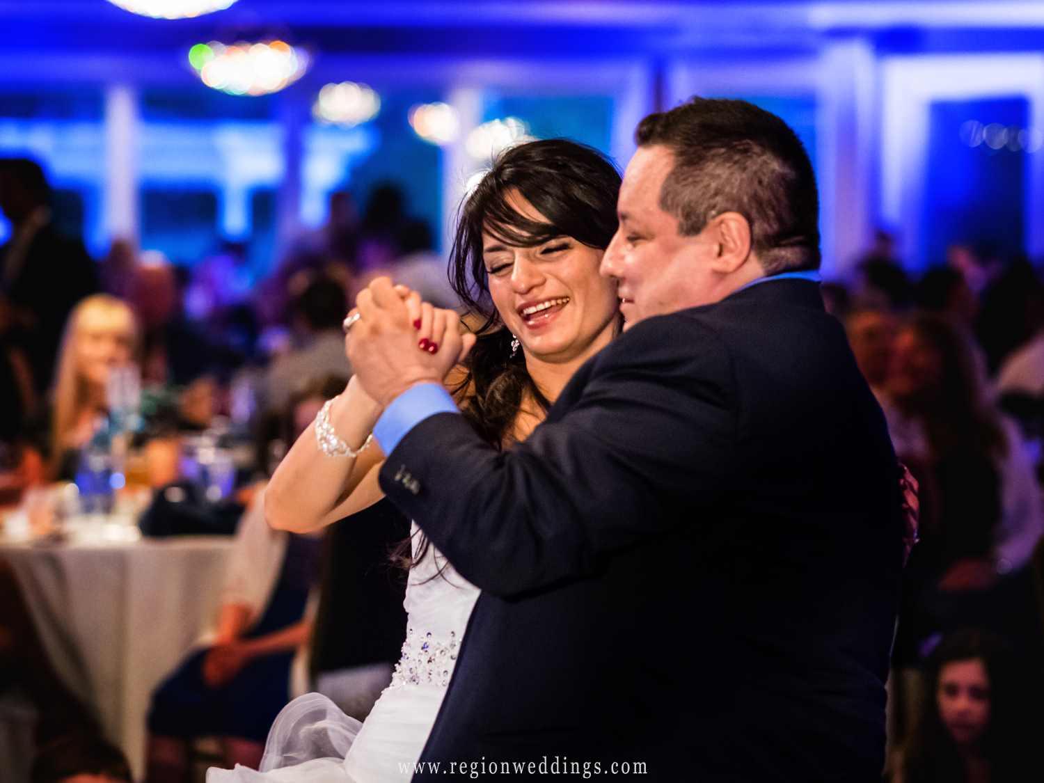 Pure joy during the father daughter dance at White Hawk Country Club.