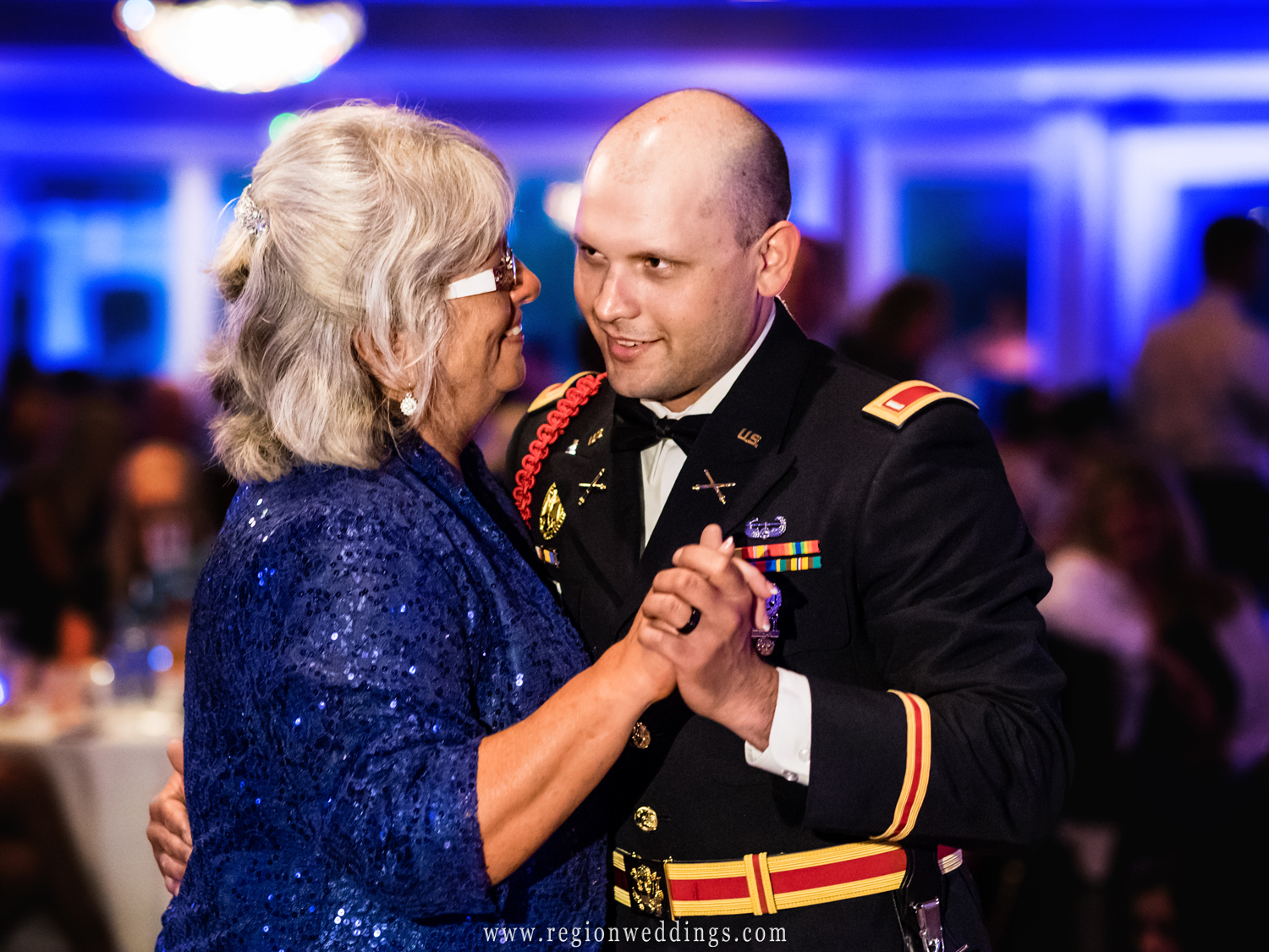 Mother and son take to the dance floor.