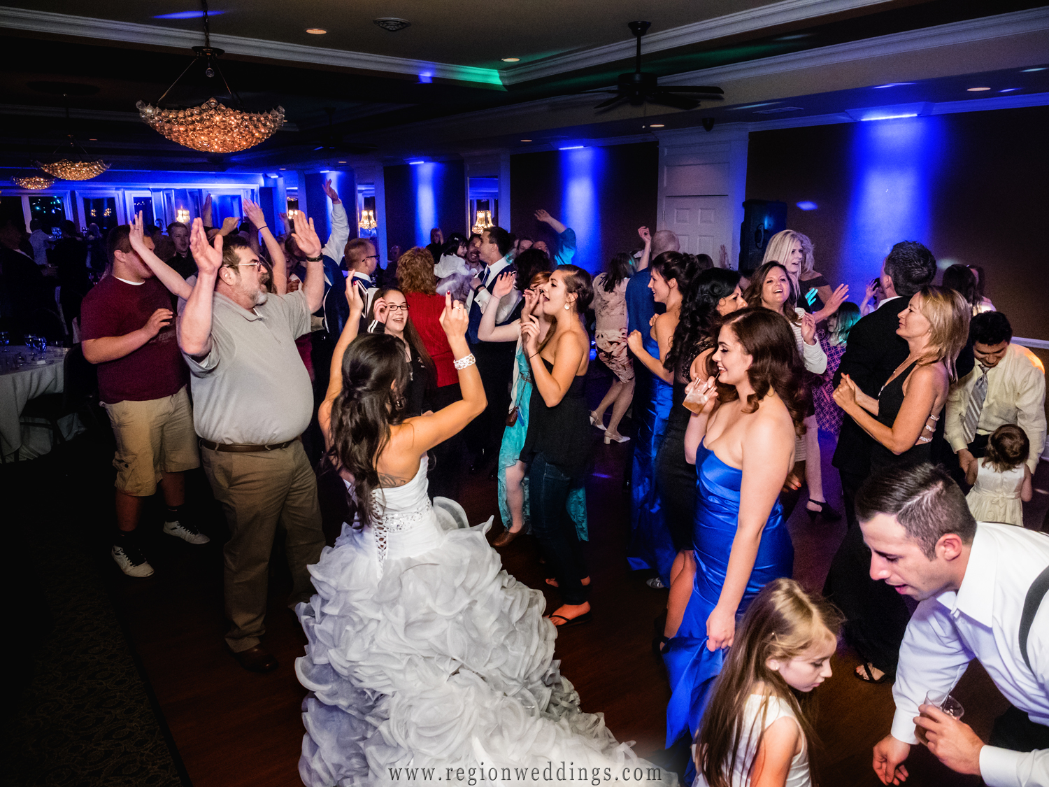 A packed dance floor for a wedding reception at White Hawk Country Club.
