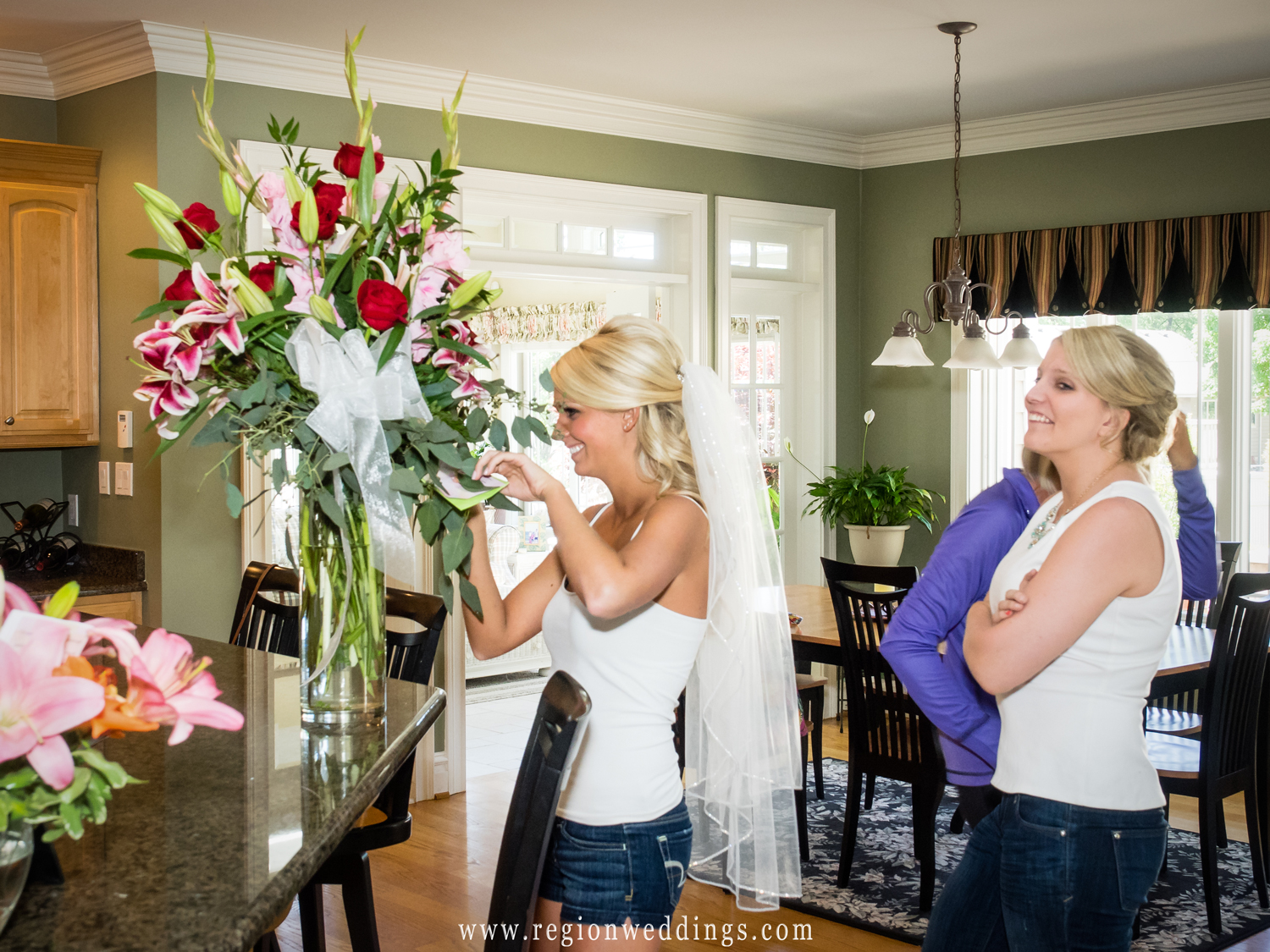 The bride receives flowers on her wedding day.