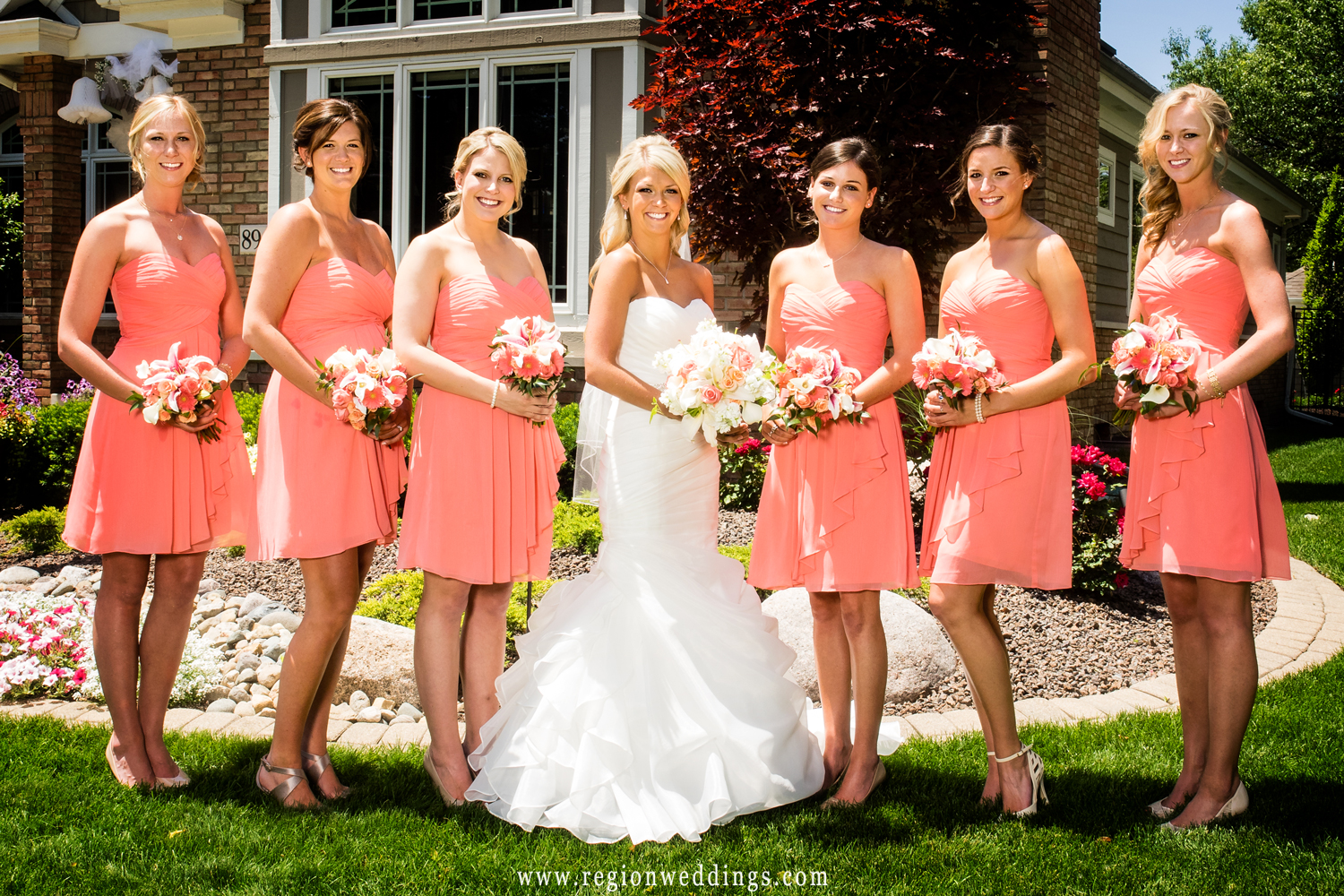 Cute picture of the bride and her girls in front of her parent's home.