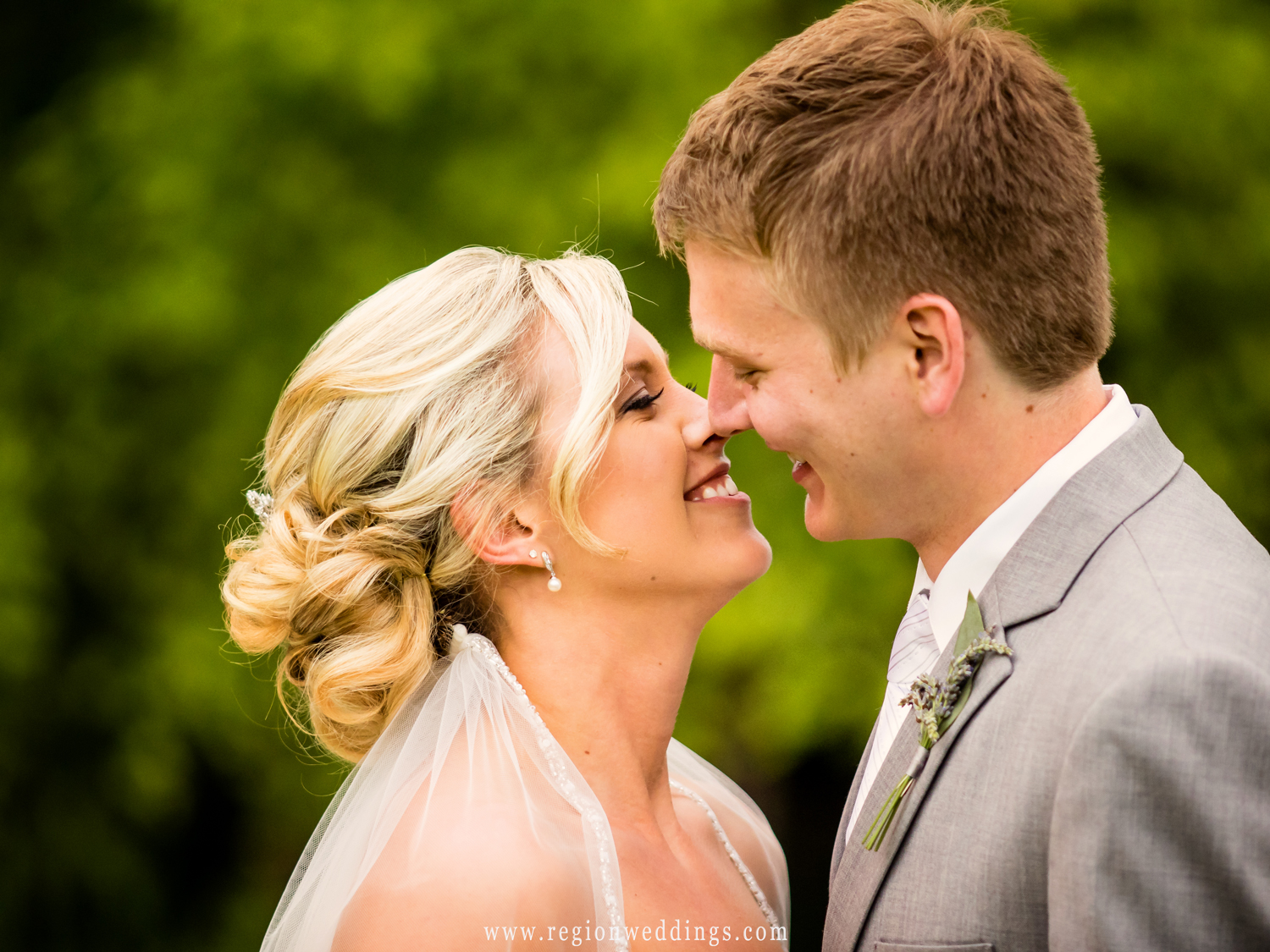 The bride and groom flirt in this candid wedding photo.