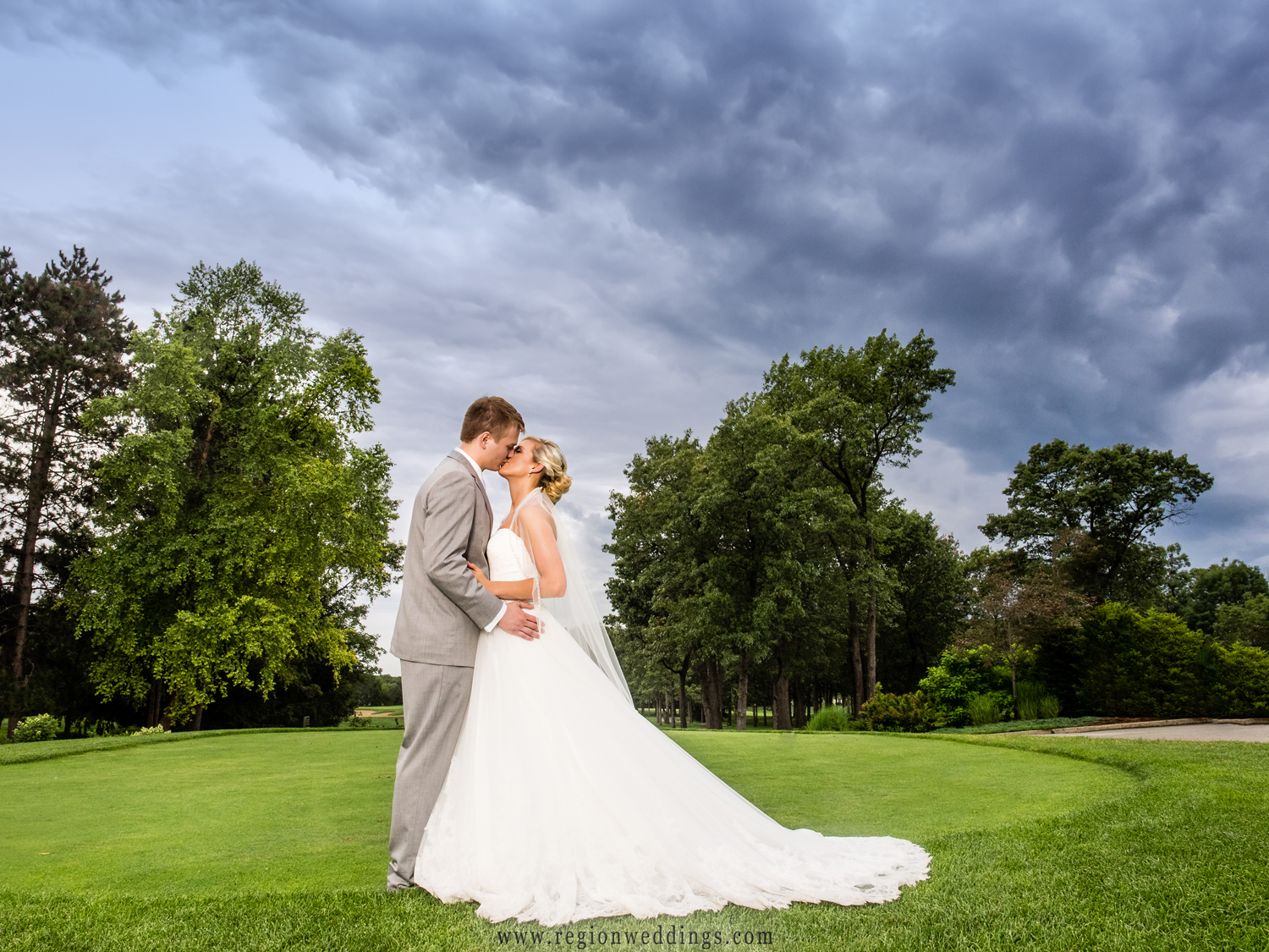 A dramatic sky wedding photo at Sandy Pines Golf Course in Demotte, Indiana.