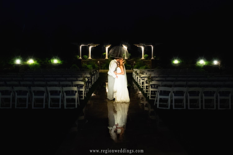 Night time wedding photo in the rain.